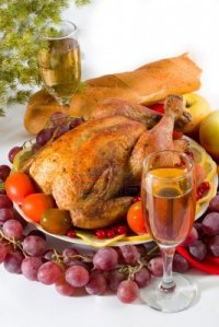 646570-roasted-chicken-or-turkey-garnished-with-lemon-cranberry-apples-tomatoes-bread-and-wine